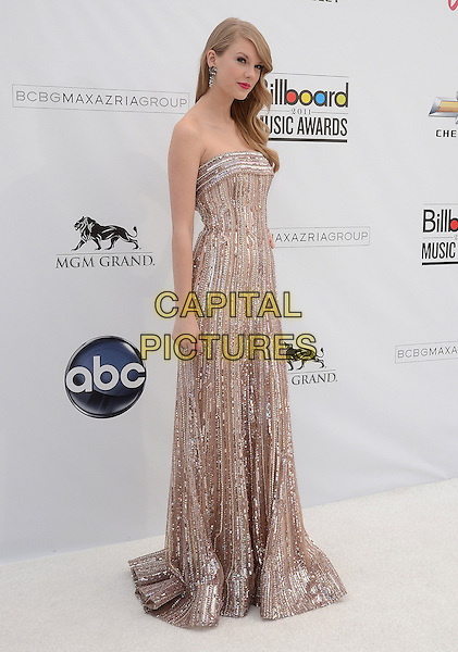 TAYLOR SWIFT.2011 Billboard Awards arrivals at the MGM Grand Garden Arena, Las Vegas, Nevada, USA..May 22nd, 2011.full length dress pink dress maxi pink strapless beads beaded bracelet.CAP/ADM/TW.©Tonya Wise/AdMedia/Capital Pictures.