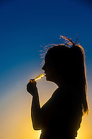 A young woman smoking marijuana in a pipe, Littleton, Colorado USA. Colorado was the first state to legalize the sale of marijuana for recreational use in 2014.
