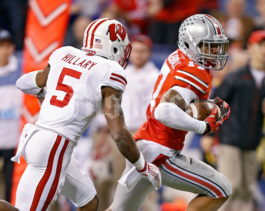 Ohio State Buckeyes running back Jalin Marshall (17) gets away from Wisconsin Badgers cornerback Darius Hillary (5) after a catch during the 1st quarter in the 2014 Big Ten Football Championship Game at Lucas Oil Stadium in Indianapolis, Ind. on December 6, 2014.  (Dispatch photo by Kyle Robertson)