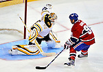 24 September 2009: Boston Bruins' goaltender Tim Thomas stops Montreal Canadiens center Scott Gomez in a shootout at the Bell Centre in Montreal, Quebec, Canada. The Bruins edged out the Canadiens in the overtime shootout 2-1 in their pre-season matchup. Mandatory Credit: Ed Wolfstein Photo