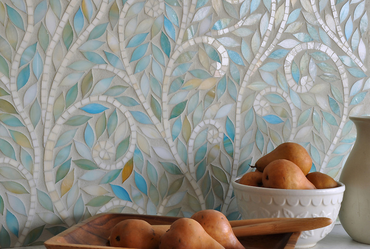 Climbing Vine, a jewel glass mosaic, is shown in Aquamarine leaves and Quartz vines.