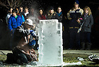 January 27, 2012; Danny Bloss II, from Food Services, carves a chainsaw ice sculpture as students gather to watch at Fieldhouse Mall. Photo by Barbara Johnston/University of Notre Dame