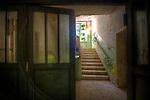 Krampnitz, an old tank barracks with dark passageway with stairs