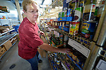Alice DeLisle, a volunteer, assembles a family food package in the Food Pantry of Urban Ministries of Wake County in Raleigh, North Carolina.