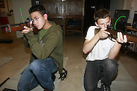 Friday, May 2nd 2008.  Point Loma High School San Diego, CA, USA.  Point Loma High School Junior ROTC classmates Sean Spratt and Alex Dolphin get ready for target practice with air rifles at the high schools firing range.