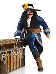 Laughing pirate with a sword and a hook opening a treasure chest full of gold and jewels. Isolated on white background