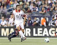 D.C. United defender Dejan Jakovic (5) passes the ball.  In a Major League Soccer (MLS) match, the New England Revolution (blue) defeated D.C. United (white), 2-1, at Gillette Stadium on September 21, 2013.