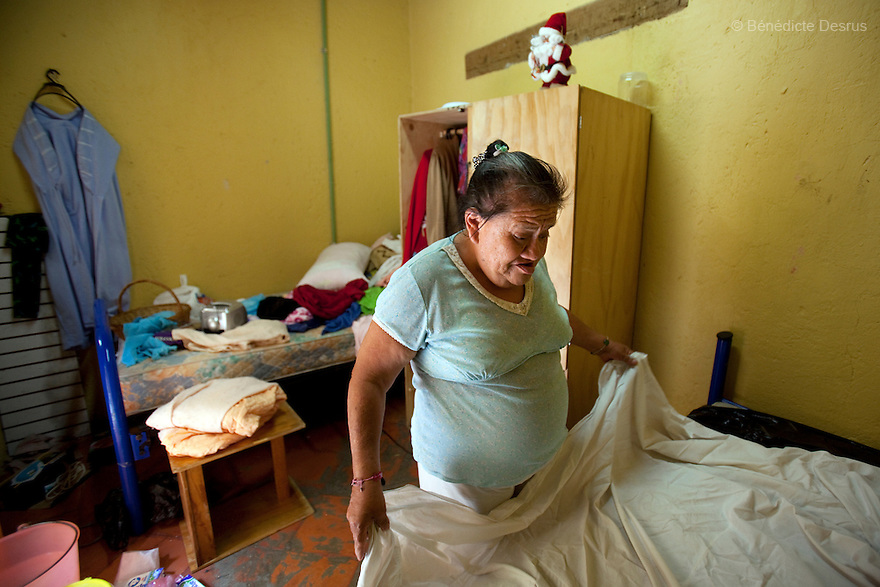 Canela, a resident of Casa Xochiquetzal, cleans up her bedroom at the shelter in Mexico City on May 17, 2011. Casa Xochiquetzal is a shelter for elderly sex workers in Mexico City. It gives the women refuge, food, health services, a space to learn about their human rights and courses to help them rediscover their self-confidence and deal with traumatic aspects of their lives. Casa Xochiquetzal provides a space to age with dignity for a group of vulnerable women who are often invisible to society at large. It is the only such shelter existing in Latin America. Photo by Bénédicte Desrus