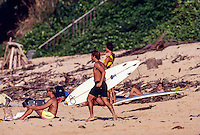Two Times World Surfing Champion Tom Curren (USA) heading out for a surf session at Backdoor on the North Shore of Oahu, Hawaii. circa 1990: Photo: Joliphotos.com