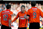 Dundee Utd v St Johnstone...25.09.10  .David Goodwillie celebrates his goal.Picture by Graeme Hart..Copyright Perthshire Picture Agency.Tel: 01738 623350  Mobile: 07990 594431