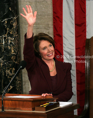 Washington, D.C. - January 4, 2007 --  United States Representative Nancy Pelosi (Democrat of the 8th District of California) waves to the galleries after she was sworn-in as the Speaker of the United States House of Representatives in the Capitol in Washington, D.C. on Thursday, January 4, 2007.  Speaker Pelosi is the first woman in U.S. history to serve in that position..Credit: Ron Sachs / CNP