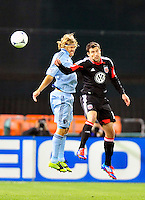 United's Chris Pontius and Sporting KC's Chance Myers goes up for a header. Sporting Kansas City defeated D.C. United 1-0 during an MLS home opener at the RFK Stadium in Washington, D.C. on Saturday, March 10, 2012. Alan P. Santos/DC Sports Box
