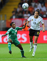 Celia Okoyino da Mbabi (r) of team Germany and Stella Mbachu of team Nigeria during the FIFA Women's World Cup at the FIFA Stadium in Frankfurt, Germany on June 30th, 2011.