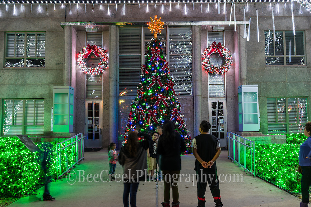 People mingling and capturing their family photos in front of the Christmas tree in Burnett Texas.  It certainly captured the sprirt of the season with all the holiday decorations in the town square in downtown  Burnet Texas.
