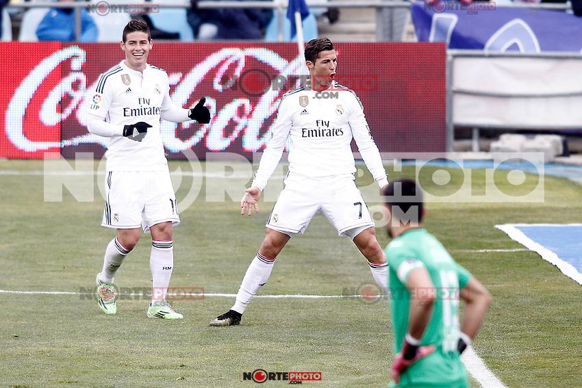 Real Madrid's James Rodriguez (l) and Cristiano Ronaldo (c) celebrate goal in presence of Getafe's Jordi Codina dejected during La Liga match.January 18,2013. (ALTERPHOTOS/Acero) /NortePhoto<br /> NortePhoto.com