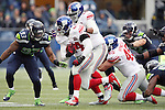 Seattle Seahawks  defensive tackle O'Brien Schofield (93) wraps up New York Giants running back Andre Williams (44) at CenturyLink Field in Seattle, Washington on November 9, 2014. The Seahawks  beat the Giants 38-17.  ©2014. Jim Bryant Photo. All Rights Reserved.