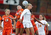COLLEGE PARK, MD - OCTOBER 28, 2012:  Olivia Wagner (11) of the University of Maryland up for a header against Ali Brennan (23) of Miami during an ACC  women's tournament 1st. round match at Ludwig Field in College Park, MD. on October 28. Maryland won 2-1 on a golden goal in extra time.