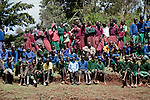 ITEN, KENYA - MAY 19: Children from different schools look at a competition as their friends are competing in Iten outside Eldoret, Kenya. Some of the best runners in the world come from his highland area,  as the high elevation is good for training. (Photo by:  Per-Anders Pettersson)
