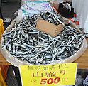 July 16th, 2011, Sendai, Japan - Small dried sardines produced in Miyagi are sold at the Tohoku Rokkon Festival, July 16, 2011, in Sendai city, Miyagi prefecture, northeastern Japan, about 90km away from the tsunami-crippled Fukushima Daiichi Nuclear Power Plant. The six major festivals in the Tohoku region, comprising Sansa Odori in Iwate, Nebuta Matsuri in Aomori, Tanabata Matsuri in Sendai, Hanagasa Matsuri in Yamagata, Kanto Matsuri in Akita, and Waraji Matsuri in Fukushima, are performed together at Tohoku Rokkon Festival for the first time to overcome the many harmful rumors and atmosphere of excessive restraint, to recover the visiting population in order to revive the regional economy, and accomplish reconstruction after the March 11's earthquake and tsunami. (Photo by Tomoyuki Kaya/AFLO) [3694]