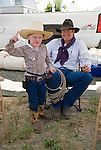 Jordan Valley Big Loop Rodeo..Amos, age 3, with his father Cliff Peterson from Washington