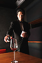 Tokyo, Japan - Kazuto Yasuda (27) works as a wine sommelier. He began through self-study and obtained his license of sommelier while he was attending a hospitality school. Now, he works for the Japanese grill restaurant Fujimaru in Aoyama, Tokyo.<br /> <br /> He comes from a family of five and his father, who used to work as a bartender and sommelier, was a big influence of his career choice. He thought of becoming a wine sommelier when he was around 15 years old. He trained himself for 2 years and now he is a professional sommelier in the central Tokyo's wealthy area.<br /> <br /> He thinks the important part of becoming sommelier is studying and working hard. He recommends &quot;Follow other's good examples. It is a good way to learn new skills.&quot; As he was studying hospitality, he is very serious about what the customer service should be like. He also indicates that it is very important to know a customer's preferences. &quot;Everything, (food, atmosphere, and customer service) must be balanced to maintain a good environment.&quot;<br /> <br /> Yasuda-san does not have any experience working overseas, but he wants to promote Japanese wines to foreign countries. He says, &quot;Wines from Japan are like Japanese traditional &quot;broth&quot;, which may look thin and clear but has a deep taste. He also invites you by saying &quot;If you have the chance to visit Japan, I will serve you with great food and service, accompanied of course with the best Japanese wines.&quot; (Photo by Hideki Yoshihara)