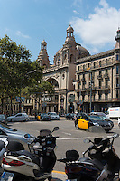 Barcelona crossing with bikes and Coliseum