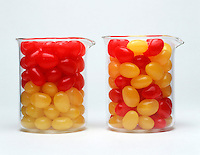 ENTROPY: ILLUSTRATION<br /> (Variations Available)<br /> Arrangement of Jellybeans in 2 Beakers.<br /> Two beakers contain red &amp; yellow beads.  Because entropy can be viewed as a measure of disorder, the arrangement in which the colors are separated represents a system of lower entropy than the one in which the colors are mixed.