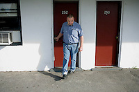 Motel Caswell owner Russell Caswell walks around the motel property in Tewksbury, Massachusetts, USA, on Tuesday, Oct. 11, 2011. Caswell's father built the motel in the 1950s. Now, conservative activitists are trying to use federal asset-forfeiture laws to seize the motel, saying that the motel is used by drug dealers to conduct business.  The legal challenge intends to show evidence tying the property to crimes in order to seize the motel.....CREDIT: M. Scott Brauer for the Wall Street Journal.slug: FORFEIT