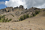 Hiker crossing open sagebrush below mountains, Sierra Nevada, Toiyabe National Forest, California