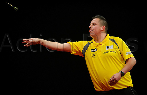 06.03.2014 Cardiff, Wales. Dave Chisnall in action against Wes Newton in a match he wins 7-5 during Judgement Night of the Betway Premier League Darts at the Motorpoint Arena.