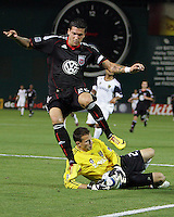 Santino Quaranta #25 of D.C. United  leaps over Kyle Reynish #24 of Real Salt Lake during an Open Cup match at RFK Stadium, on June 2 2010 in Washington DC. DC United won 2-1.