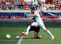 Chicago defender Austin Berry (22) slide tackles the ball away from LA Galaxy defender Todd Dunivant (2).  The LA Galaxy defeated the Chicago Fire 2-0 at Toyota Park in Bridgeview, IL on July 8, 2012.
