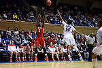 28 November 2014: Stony Brook's Jessica Ogunnorin (GRE) (3) shoots over Duke's Ka'lia Johnson (14). The Duke University Blue Devils hosted the Stony Brook University Seahawks at Cameron Indoor Stadium in Durham, North Carolina in a 2014-15 NCAA Division I Women's Basketball game. Duke won the game 72-42.