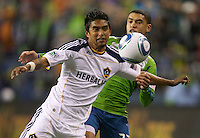 L.A. Galaxy defender A.J. DeLaGarza  battles Seattle Sounders forward Lamar Neagle during play between at Qwest Field in Seattle Tuesday March 15, 2011. The Galaxy won the game 1-0.