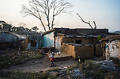 A young girl washes her face next to the abandoned homes in Lantengunj in Jharia, outside of Dhanbad in Jharkhand, India.  Photo: Sanjit Das/Panos