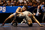 LA CROSSE, WI - MARCH 11: Nathan Pike of NYU tangles up with Jay Albis of Johnson & Wales in the 133 weight class during NCAA Division III Men's Wrestling Championship held at the La Crosse Center on March 11, 2017 in La Crosse, Wisconsin. Pike beat Albis with a fall to win the National Championship. (Photo by Carlos Gonzalez/NCAA Photos via Getty Images)