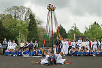 Charlton-on-Otmoor Oxfordshire May Day Celebrations. Children from the Church of England St Mary the Virgin Primary School process to the village church to have their May garlands blessed. The garlands are then hung on the church Rood Screen. After the May Garland Service children take part in traditional May pole dances in the car park of the Crown Inn.