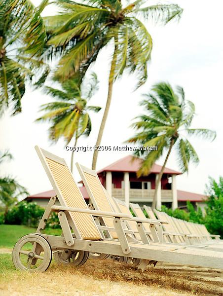 Beach chairs at the Cap Est Lagoon Resort & Spa. Cap Est, Martinique. Eastern Caribbean.