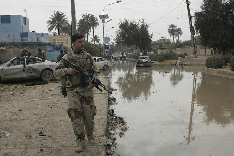 BAQUBA, IRAQ:  Security forces patrol after a series of bombings in the Iraqi city of Baquba...Three bombs went off in Baquba, the capital of Diyala Province, killing at least 30 people.  The first two bombs were at 9: 30 in the morning.  The third bomb was at a local hospital where the victims were being taken...Photo by Metrography.