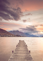 The Frankton Jetty at sunset, looking across Lake Wakatipu towards Cecil and Walter Peak, Queenstown, New Zealand
