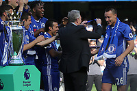 Richard Scudamore, Chief Executive of the Premier League, presents John Terry with his Premier League medal during Chelsea vs Sunderland AFC, Premier League Football at Stamford Bridge on 21st May 2017