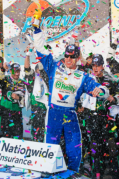 Nov. 14, 2009, Phoenix, AZ: Carl Edwards climbs from his car to celebrate his victory in the Nationwide Race.