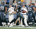 Seattle Seahawks linebacker  Aaron Curry returns a pass interception against the Minnesota Vikings at CenturyLink Field in Seattle, Washington August 20, 2011. The Vikings beat the Seahawks  20-7. ©2011 Jim Bryant Photo. All Rights Reserved.