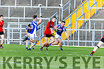 Kenmare's Kevin O'Sullivan is just about to pull the trigger but is tackeld by Templenoe Danny Cahalane and John Crowley-Holland to give away a penalty  during the County Intermediate Championship final in Fitzgerald Stadium on Sunday