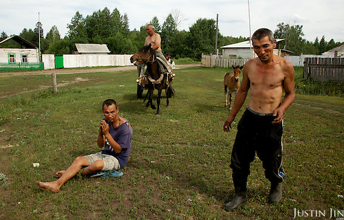 Drunken villagers loiter in the Chodura village in the Tuva Republic, southern Siberia, Russia. Alcoholism is rife in the region.