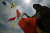 LUTZ TRECZOCKS AND HIS YELLOW &quot;STOP PLUTONIUM&quot; KITE, JAPAN. 030702. .PIC &copy; JEREMY SUTTON-HIBBERT/GREENPEACE 2002..*****ALL RIGHTS RESERVED. RIGHTS FOR ONWARD TRANSMISSION OF ANY IMAGE OR FILE IS NOT GRANTED OR IMPLIED. CHANGING COPYRIGHT INFORMATION IS ILLEGAL AS SPECIFIED IN THE COPYRIGHT, DESIGN AND PATENTS ACT 1988. THE ARTIST HAS ASSERTED HIS MORAL RIGHTS. *******