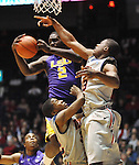 "LSU's Johnny O'Bryant III (2) grabs a rebound against Mississippi's Jarvis Summers (32) and Mississippi's Reginald Buckner (23) at the C.M. ""Tad"" Smith Coliseum in Oxford, Miss. on Saturday, February 25, 2012. (AP Photo/Oxford Eagle, Bruce Newman).."