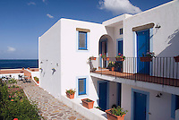 Salina, Eolian Islands, Italy, June 2006. All houses, including the hotels are built in the old style to Unesco supported rules. The Volcanic Eolian Islands of Southern Italy offer a spectacular landscape for trekking while staying in picturesque towns. Photo by Frits Meyst/Adventure4ever.com