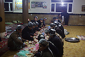 BIARA, IRAQ: The students eat dinner in the mosque...The Biara Madrassa--a religious school--is located high up in the mountainous Kurdish Hawraman region that makes up the Iran/Iraq border. Before 2003 the region was home to a fundamentalist Islamic group called Ansar al-Islam who used the school as a base. The Unites States military attacked the area and the madrassa numerous times during the 2003 invasion, finally pushing Ansar al-Islam out...Today the madrassa is home to 48 male students from all across Kurdish Iraq. The students leave their families and immerse themselves in their studies and the daily life of Koranic students...Photo by Besaran Tofiq