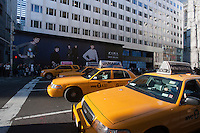 Taxis wait at a traffic light on Fifth Avenue in front of a construction shed promoting a new Zara store in New York on Black Friday, the day after Thanksgiving, Friday, November 25, 2011. Many retailers opened their doors on Thanksgiving or opened up for Black Friday the night before extending the shopping day into over 24 hours. (© Richard B. Levine)